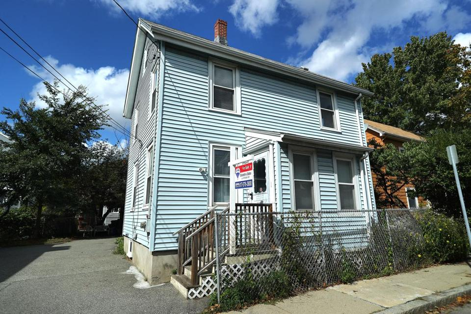 This 1,504-square-foot Cambridgeport single-family house with light blue siding is listed at $950,000.